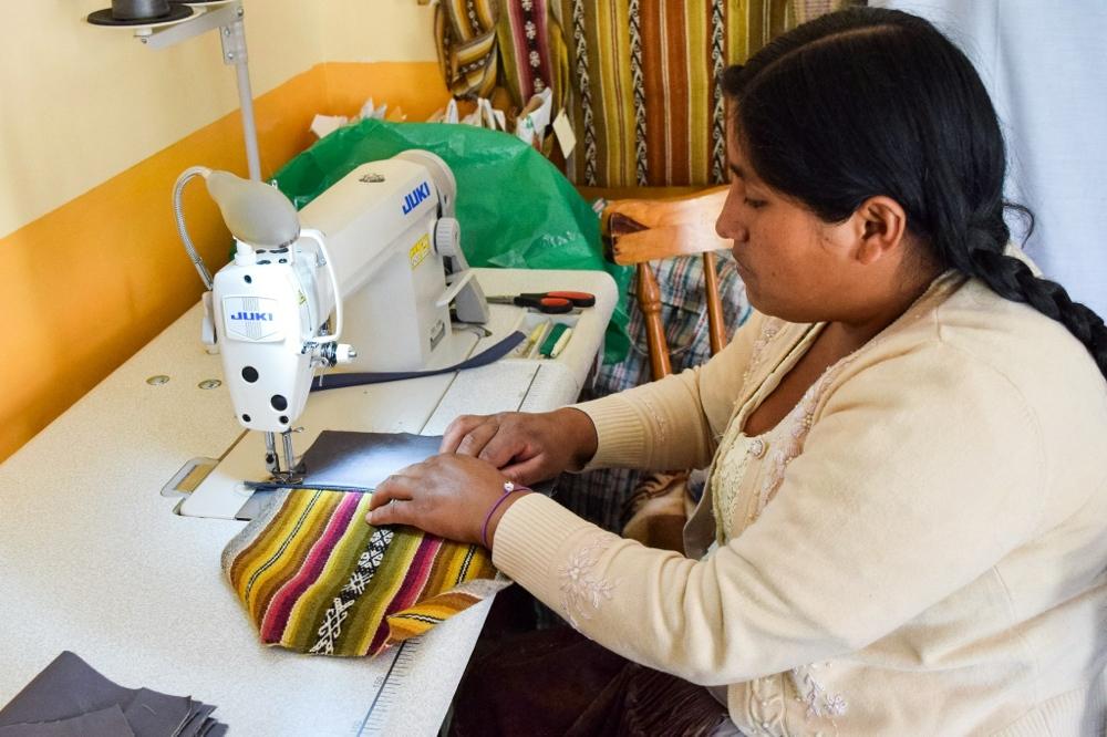 Sewing traditional weavings