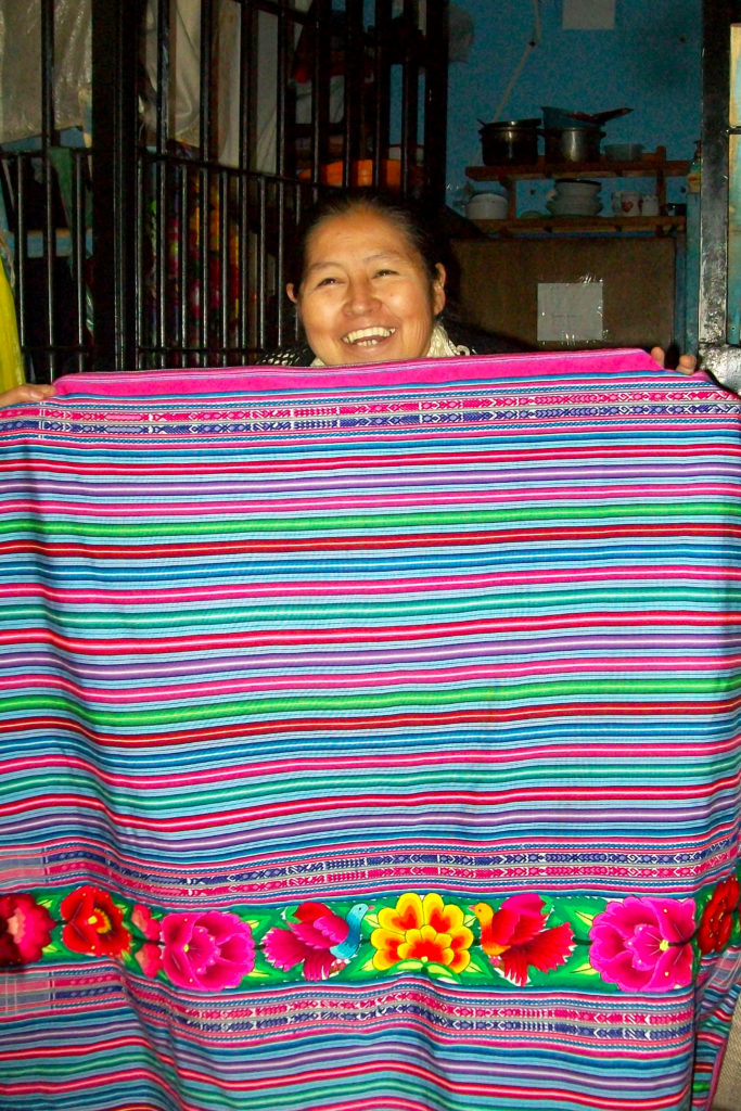Showing off a beautiful manta she embroidered