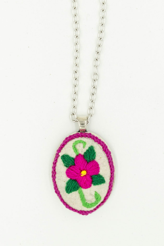 Embroidered pendant by Lucila