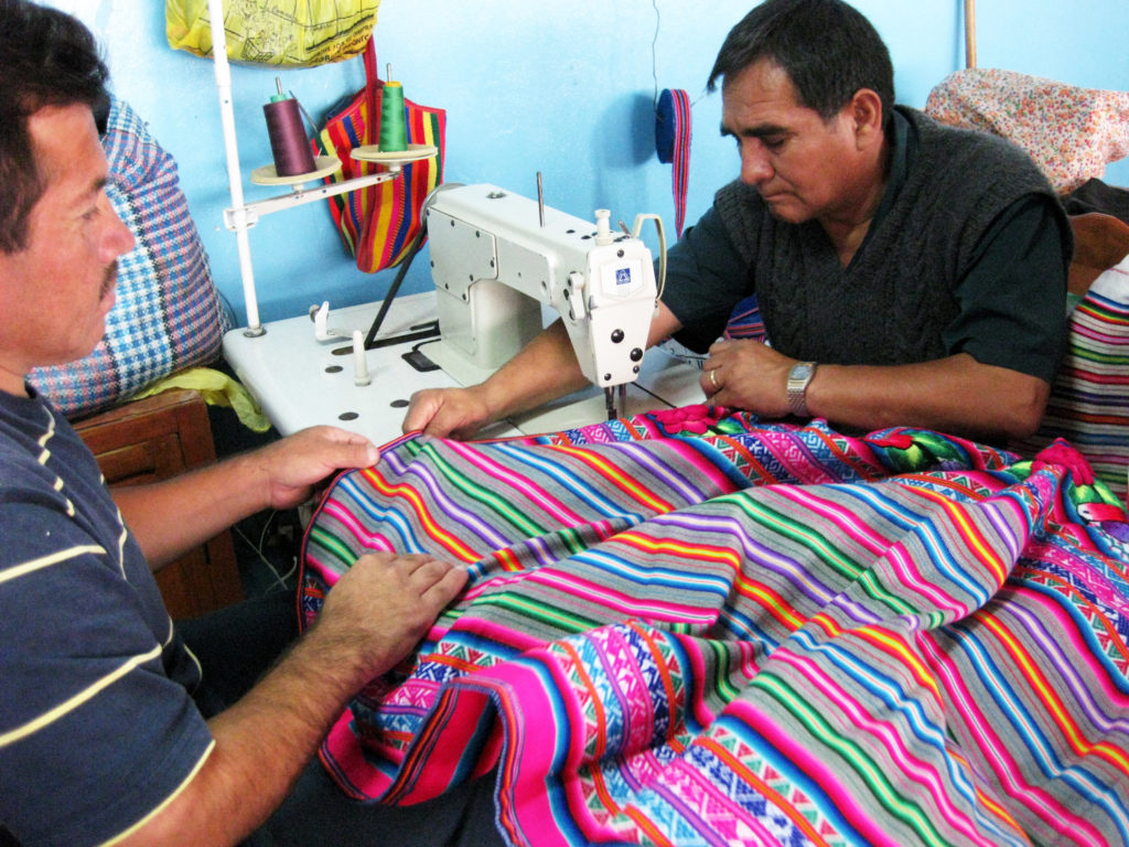 Men Sewing Manta